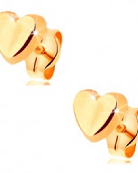 Náušnice v žltom 14K zlate - drobné srdiečko s jemne vypuklým povrchom