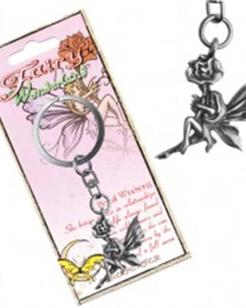 Kovový prívesok na kľúče - lesklá víla držiaca kvet, patina AC1.23