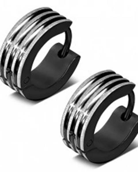 Okrúhle náušnice z ocele čiernej farby, vyvýšené pásiky v striebornom odtieni