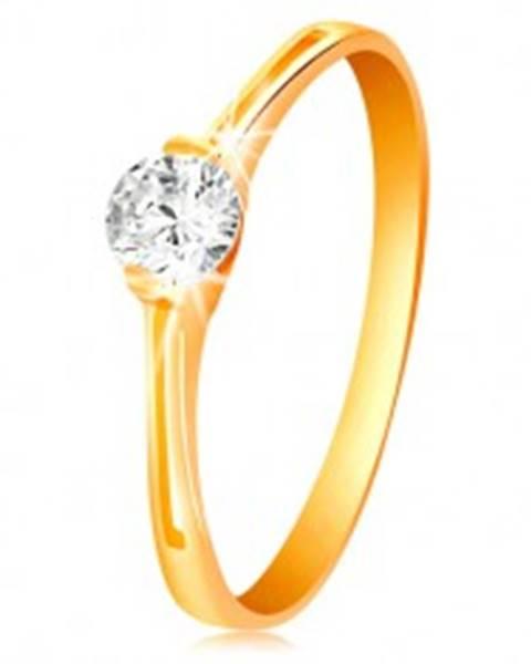 Prsteň v žltom zlate 585 - žiarivý číry zirkón v lesklom kotlíku, výrezy - Veľkosť: 50 mm